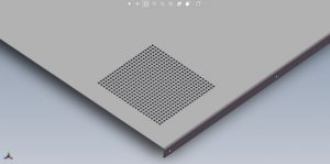CAD rendering of sheet metal panel with dense circular cutout pattern.