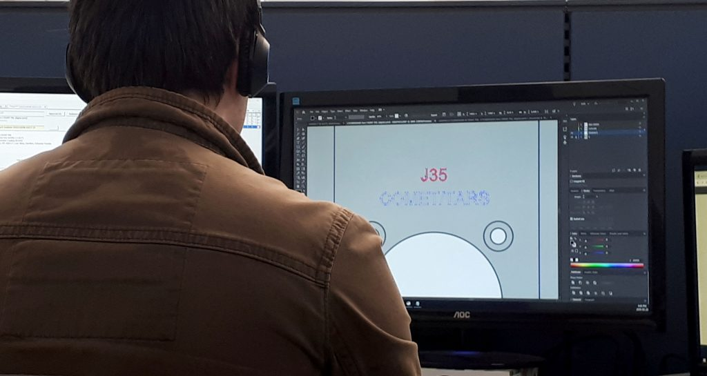 Protocase graphics specialist Josh Currie works on a customer's order