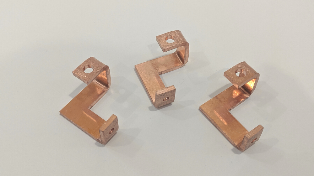 Custom copper bus bar with bends and cutouts