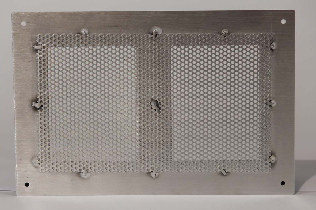 Backside of Perforated Aluminum Sheet Metal with Grained Finish, Fastened via Spot Weld
